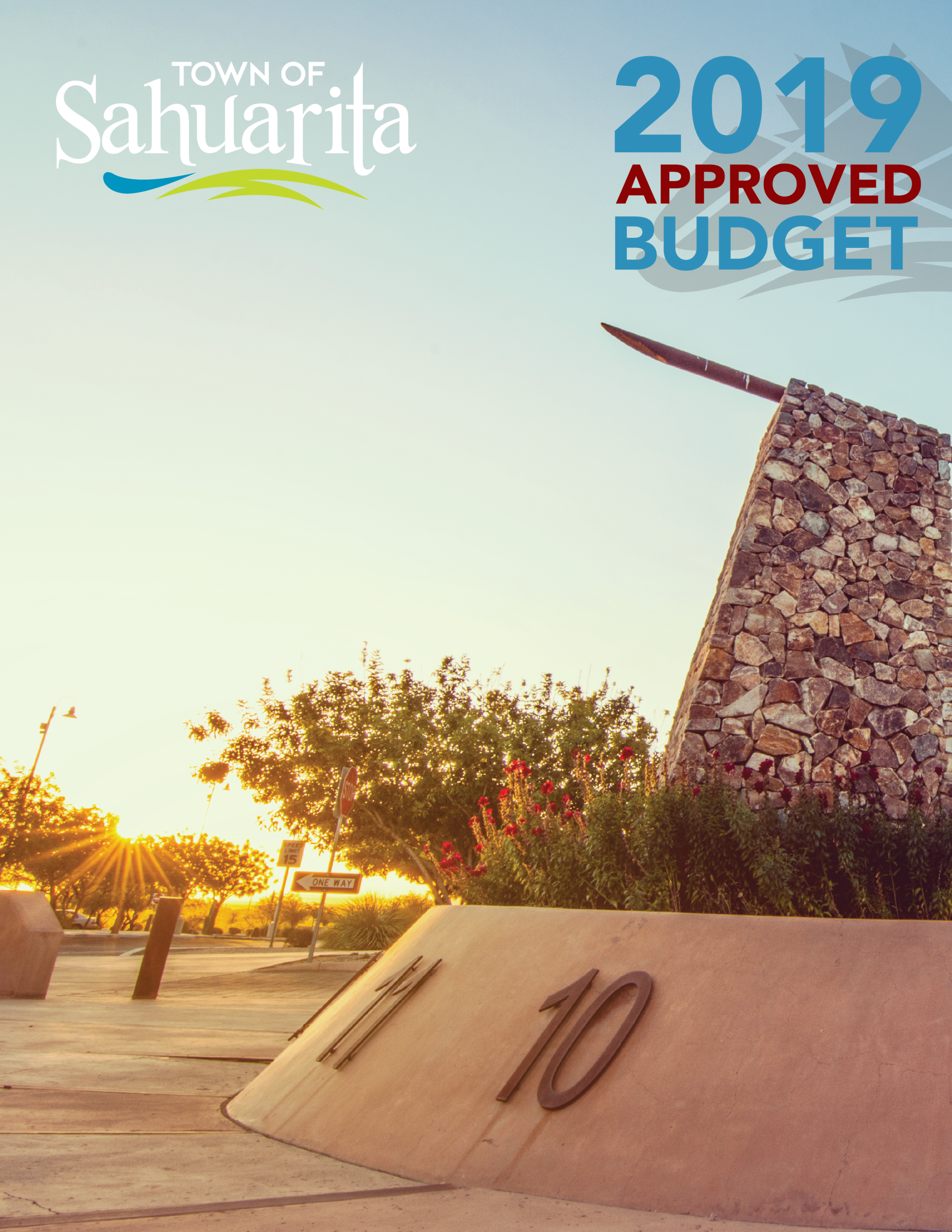 COVER-APPROVED BUDGET-2019 - Sahuarita Town Hall sundial, fountain and flowers in front of Town Hall